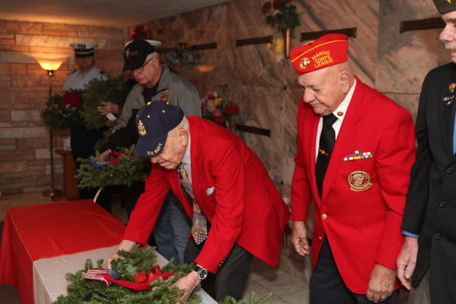 WW II and Korean War Veteran Joe Winn, at the age of 99, places a wreath during Wreaths Across America Day at Resthaven Memorial Gardens on Saturday, December 15, 2018, in Clarksville, Tennessee.