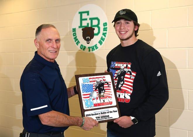 Marcus Borden presents East Brunswick's Tim Gudzak with the Borden's Baller of the Year plaque.