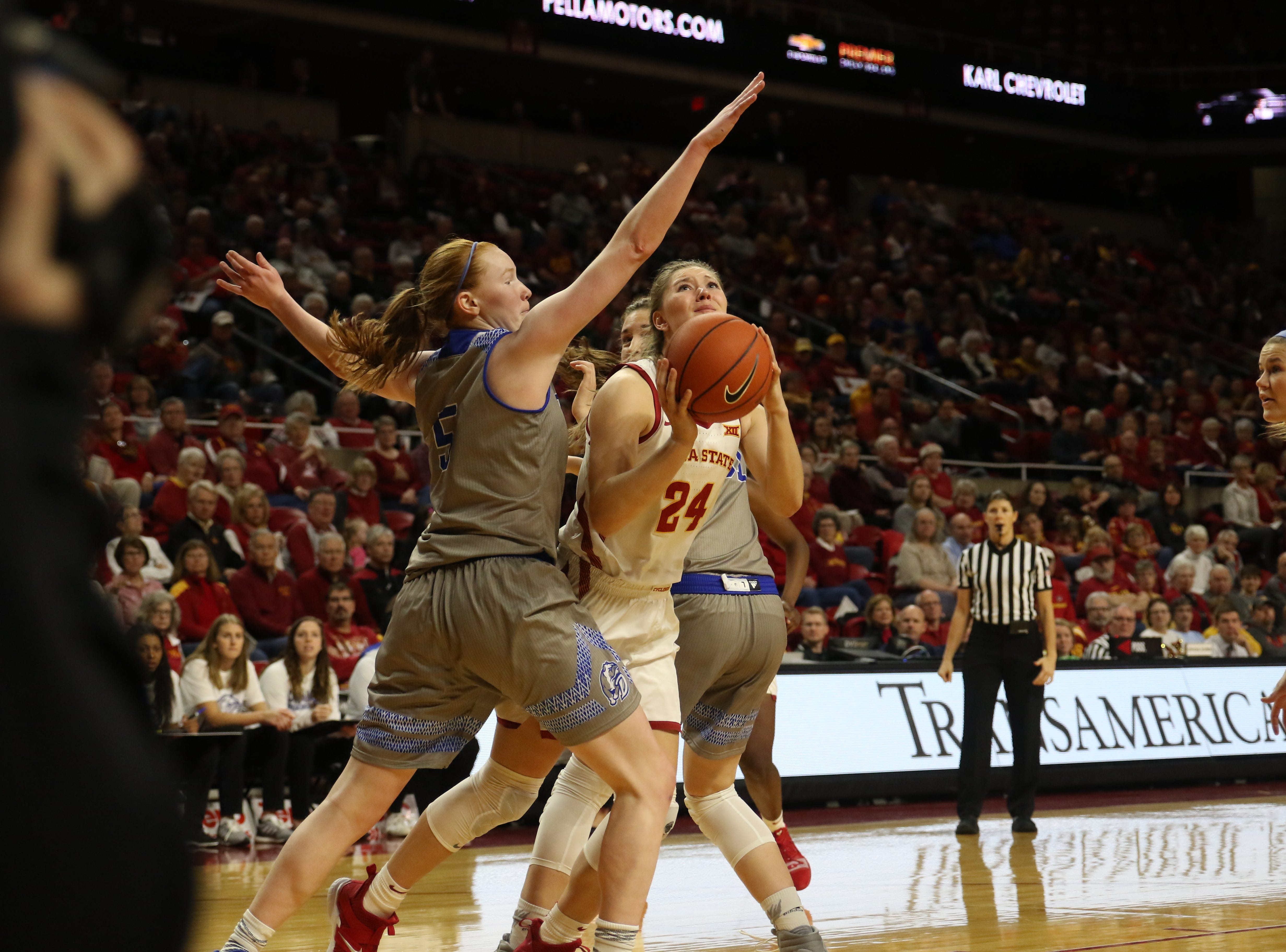 Iowa State freshman Ashley Joens attempts a shot in traffic during the Cyclones 86-81 win over Drake on Sunday.