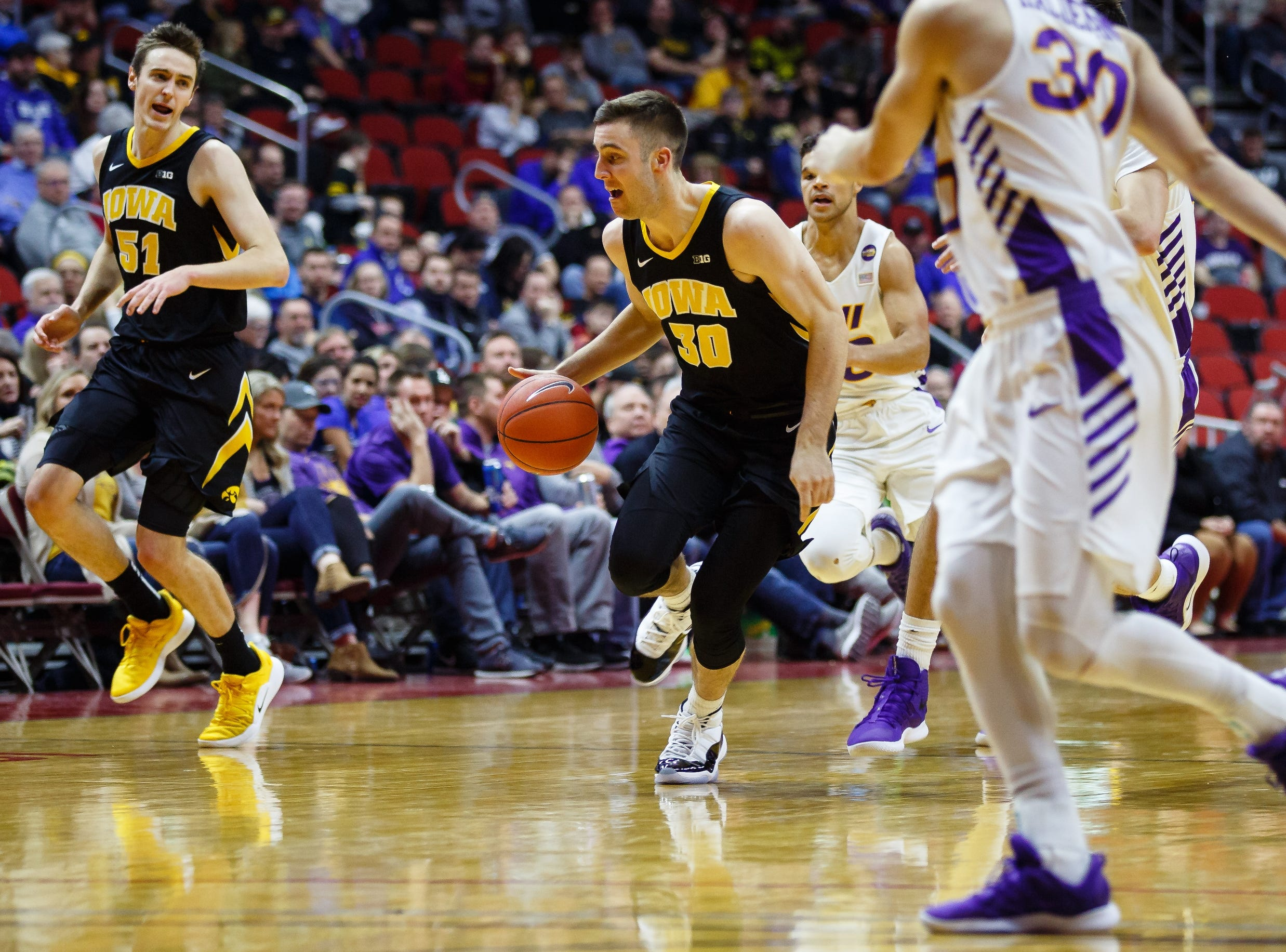 Iowa's Connor McCaffery (30) dribbles during their basketball game at the Hy-Vee Classic on Saturday, Dec. 15, 2018, in Des Moines. Iowa would go on to defeat UNI 77-54.