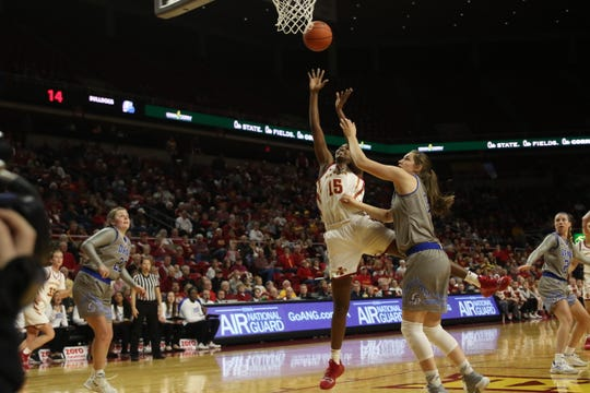 Iowa State senior Ines Nezerwa floats a shot in despite tight defense by Drake. The Cyclones defeated Drake, 86-81.