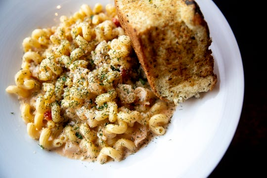 The lobster mac & cheese from the downtown classic Americana, on Tuesday, Dec. 11, 2018. This mac comes with a tomato and onion compote, topped with lemon and dill.
