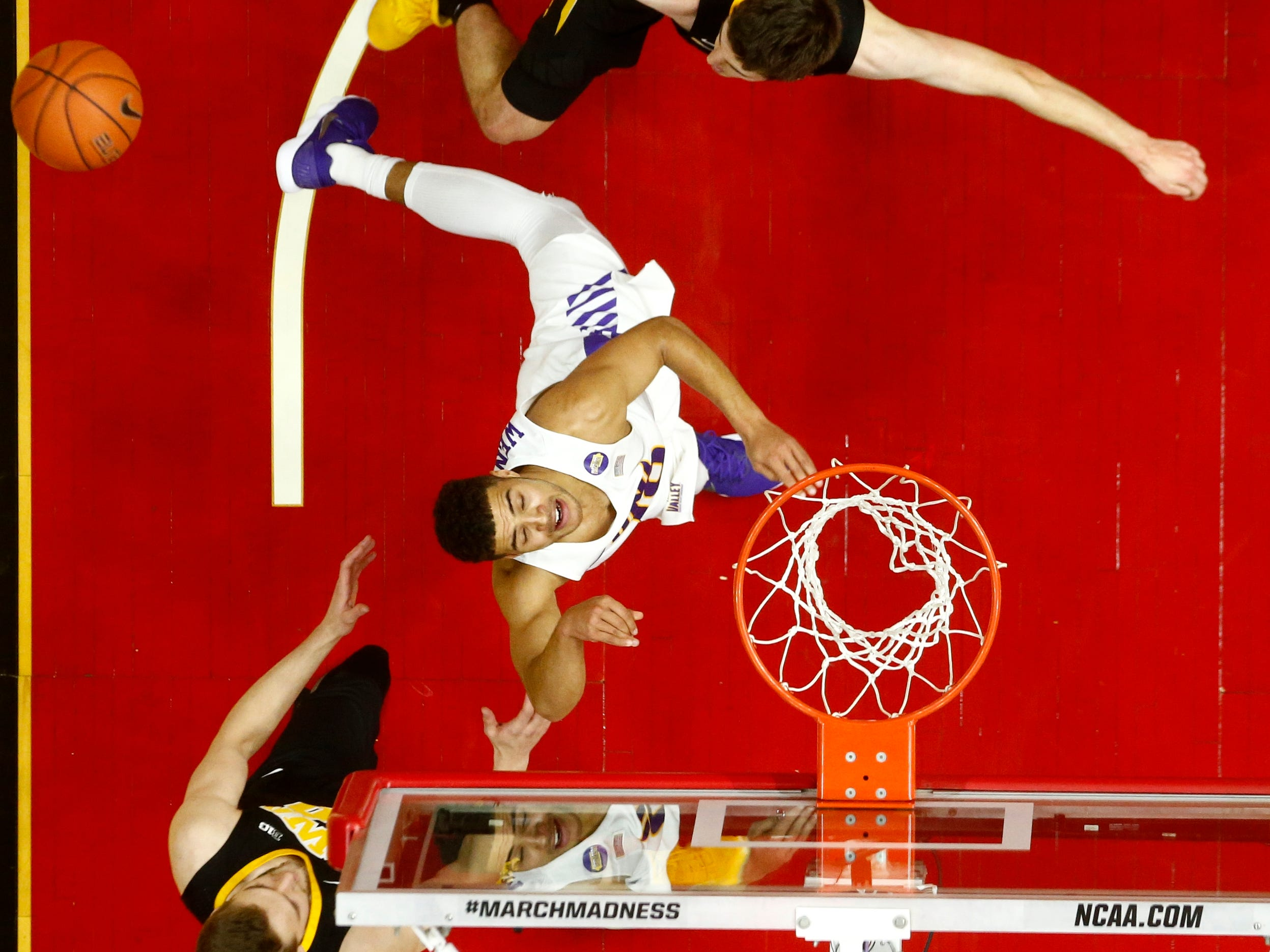 Iowa State's Nate Schuster (10) is fouled under the net during their basketball game at the Hy-Vee Classic on Saturday, Dec. 15, 2018, in Des Moines. Iowa would go on to defeat UNI 77-54.