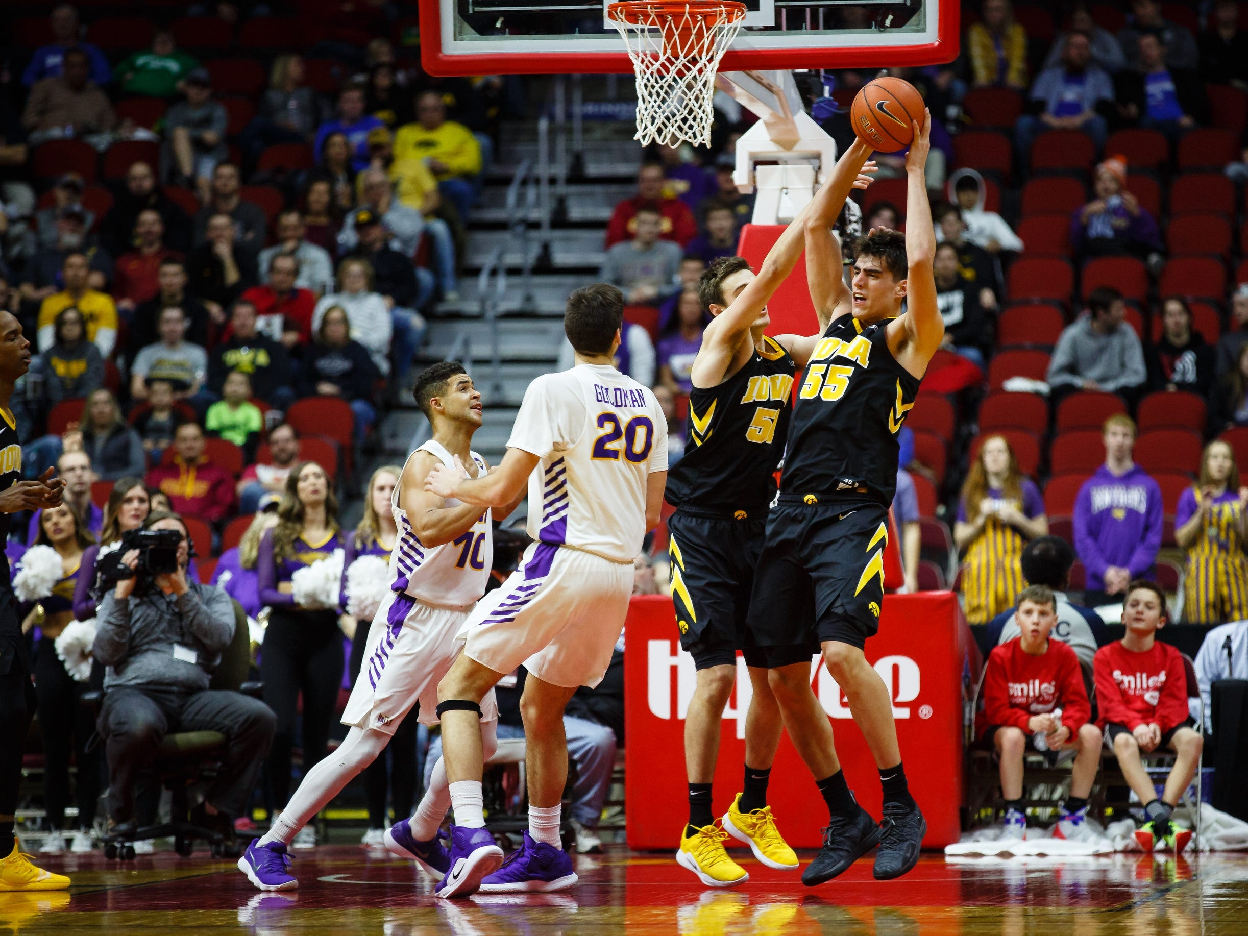 Iowa's Luka Garza (55) gets a rebound during their basketball game at the Hy-Vee Classic on Saturday, Dec. 15, 2018, in Des Moines. Iowa would go on to defeat UNI 77-54.