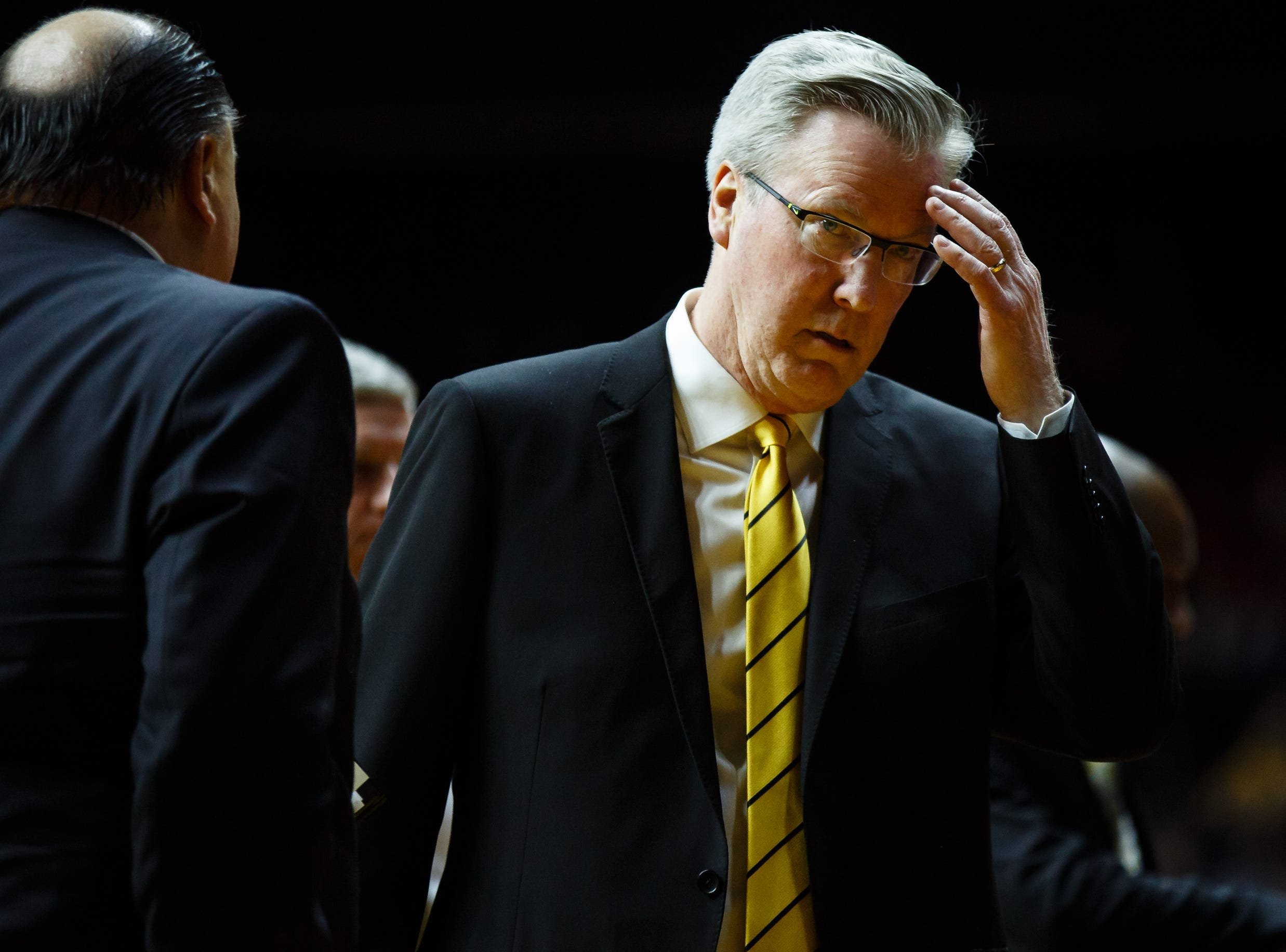 Iowa head coach Fran McCaffery talks to his coaching staff during their basketball game at the Hy-Vee Classic on Saturday, Dec. 15, 2018, in Des Moines. Iowa would go on to defeat UNI 77-54.