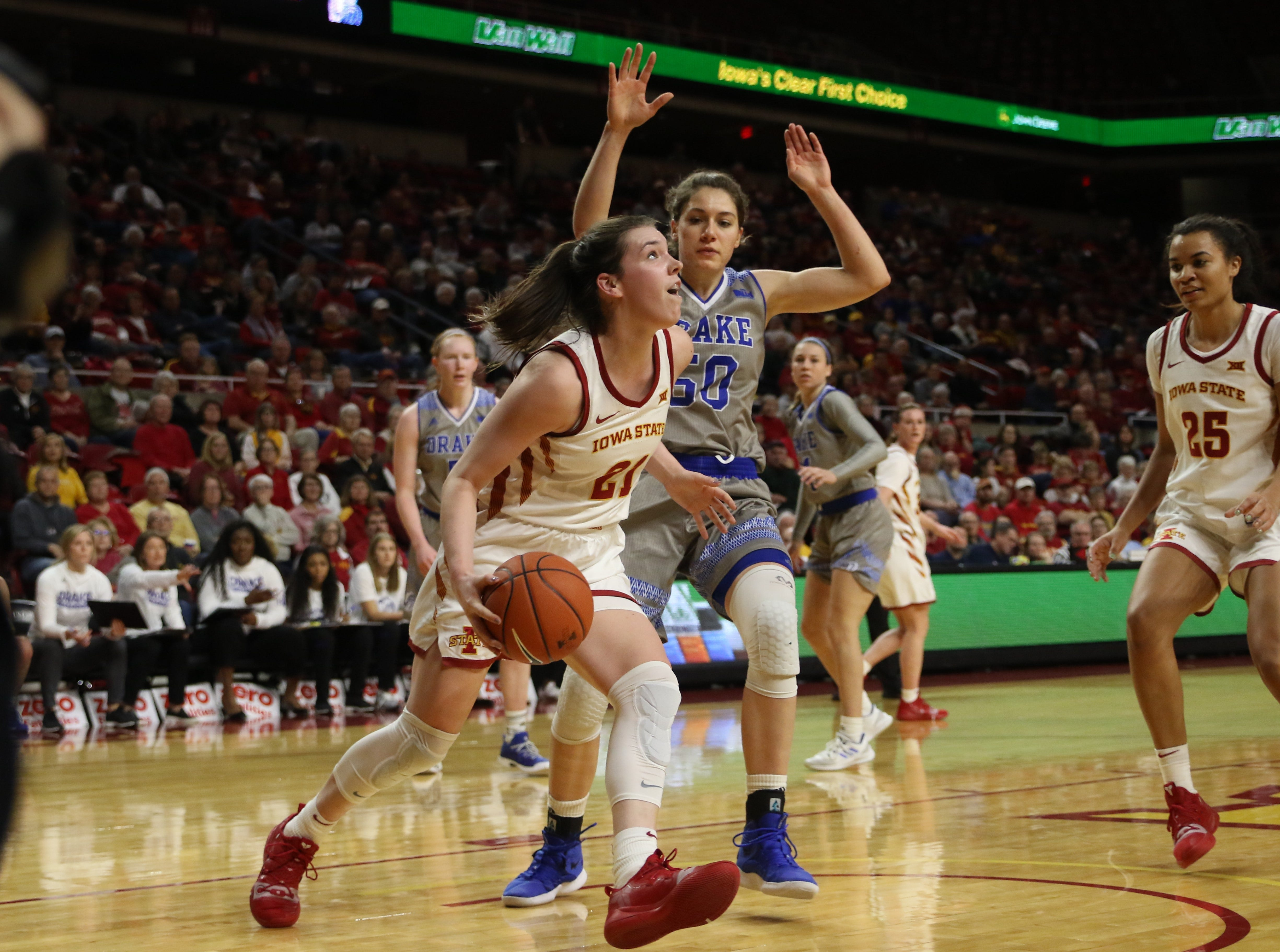 Iowa State senior Bridget Carleton drives in on her way to making a layup against Drake on Sunday. Carleton provided a spark for Iowa State in their 86-81 win.
