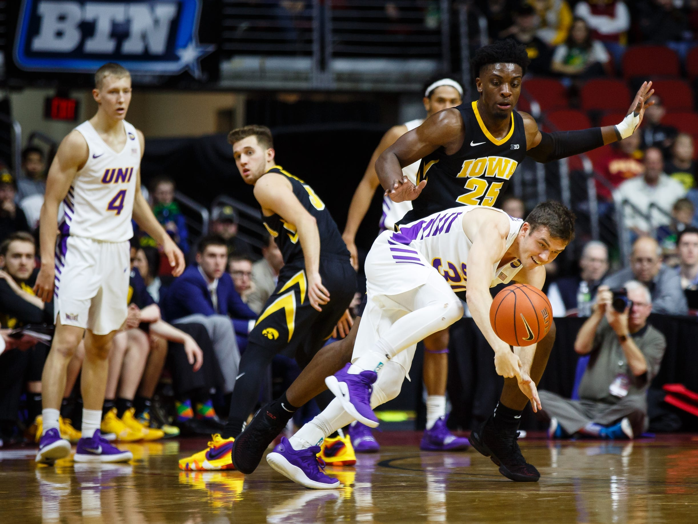 UNI's SpencerÊHaldeman (30) has the ball knocked away from him during their basketball game at the Hy-Vee Classic on Saturday, Dec. 15, 2018, in Des Moines. Iowa takes a 39-18 lead over UNI into halftime.