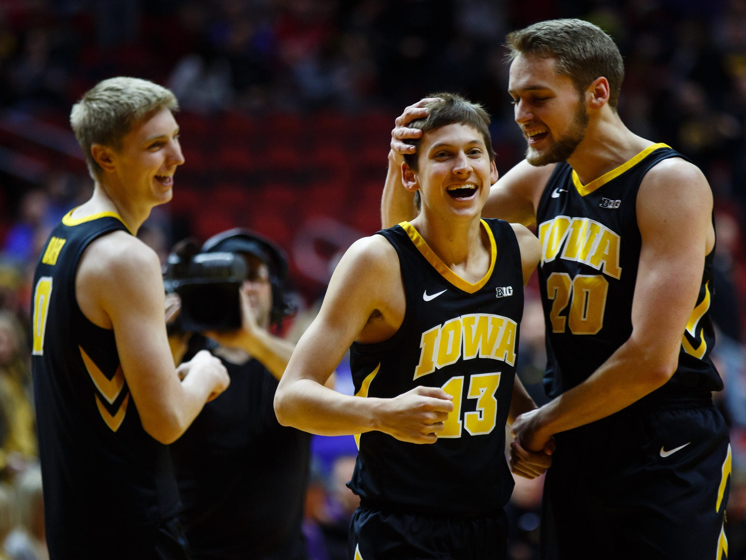 Iowa's Austin Ash (13) is congratulated by Iowa's Riley Till (20) after making a three point shot during their basketball game at the Hy-Vee Classic on Saturday, Dec. 15, 2018, in Des Moines. Iowa would go on to defeat UNI 77-54.