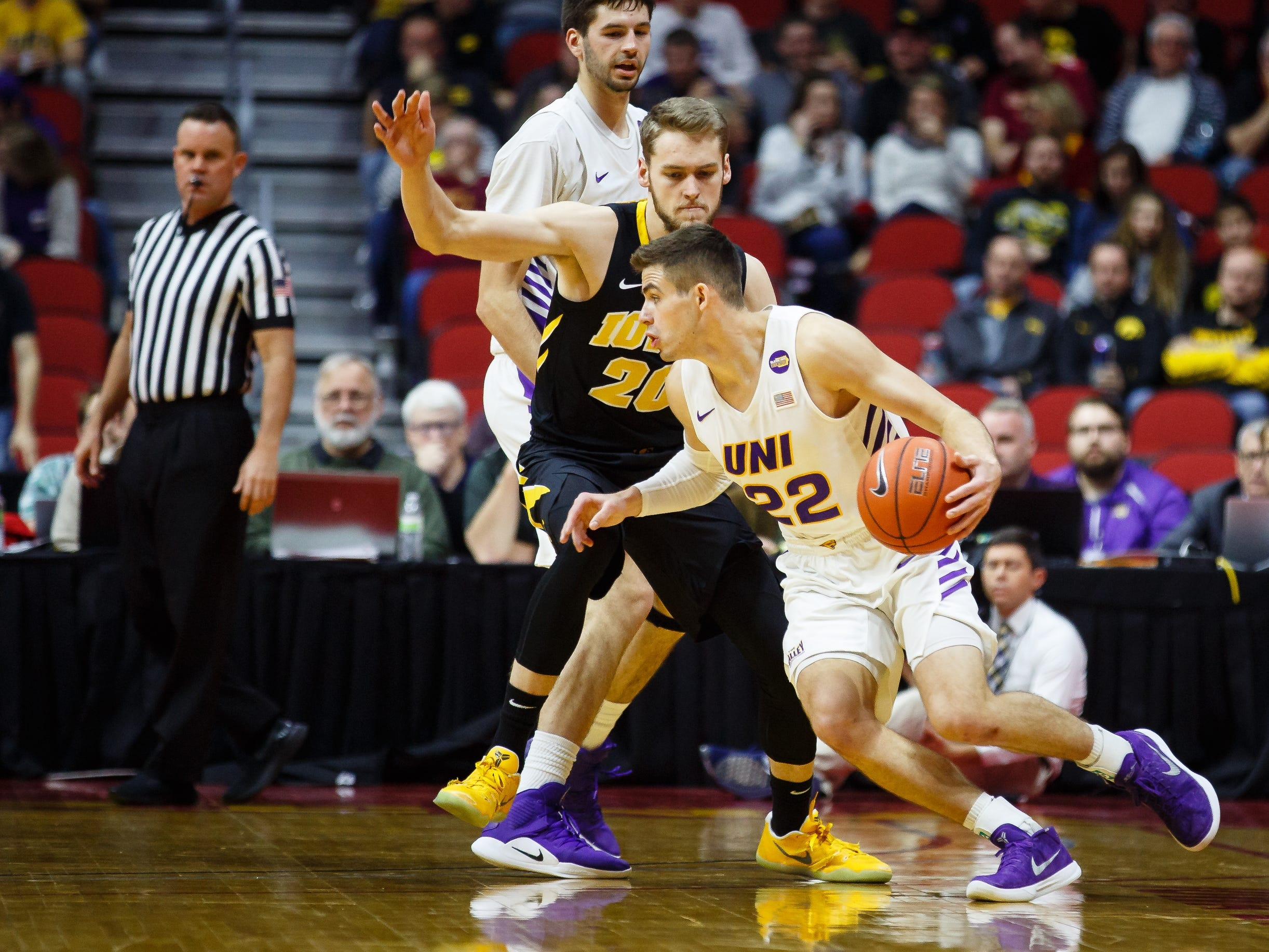 UNI's WyattÊLohaus (22) dribbles around Iowa's Riley Till (20) during their basketball game at the Hy-Vee Classic on Saturday, Dec. 15, 2018, in Des Moines. Iowa would go on to defeat UNI 77-54.