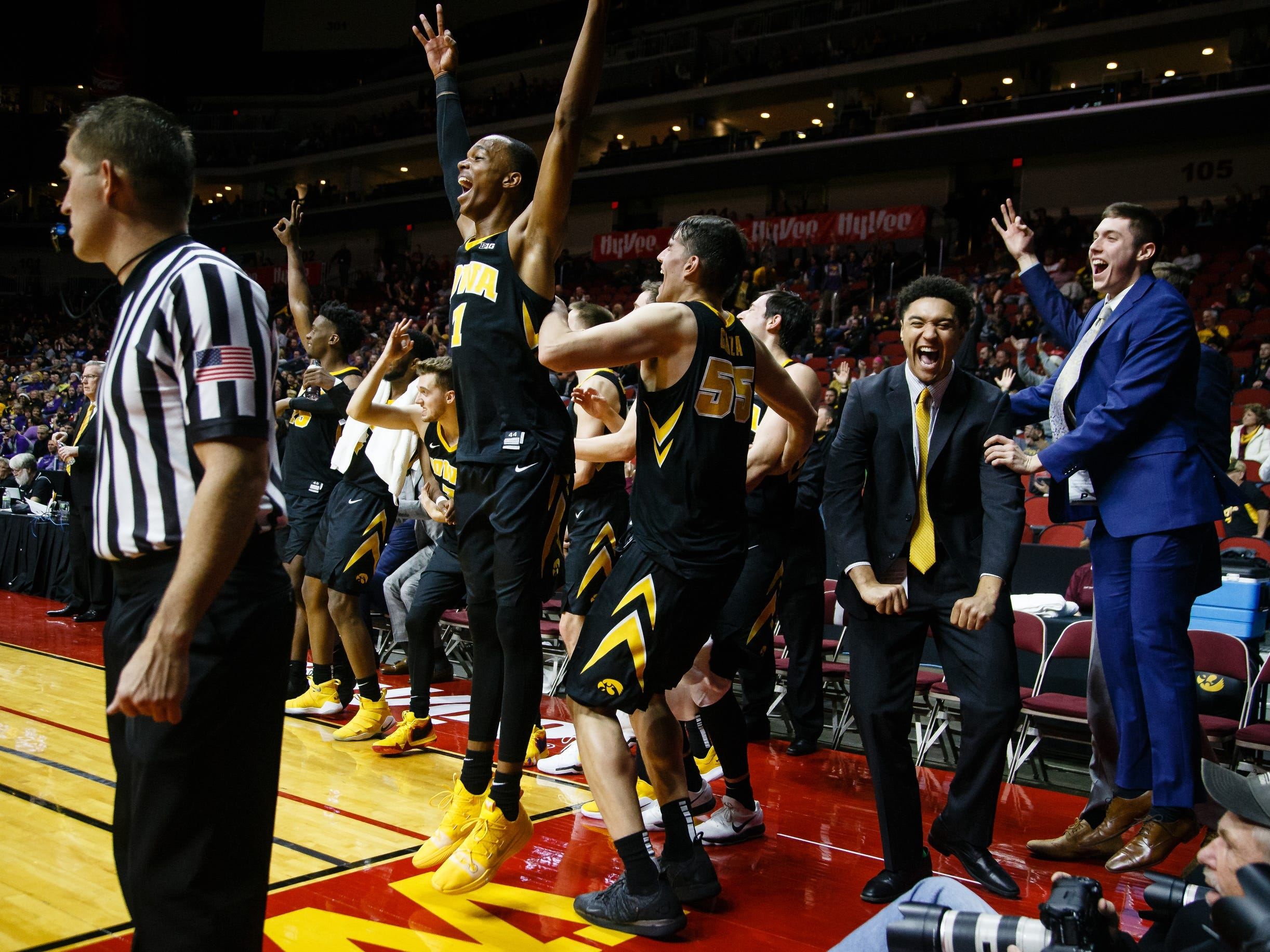 The Iowa bench erupts after Austin Ash made a three during their basketball game at the Hy-Vee Classic on Saturday, Dec. 15, 2018, in Des Moines. Iowa would go on to defeat UNI 77-54.