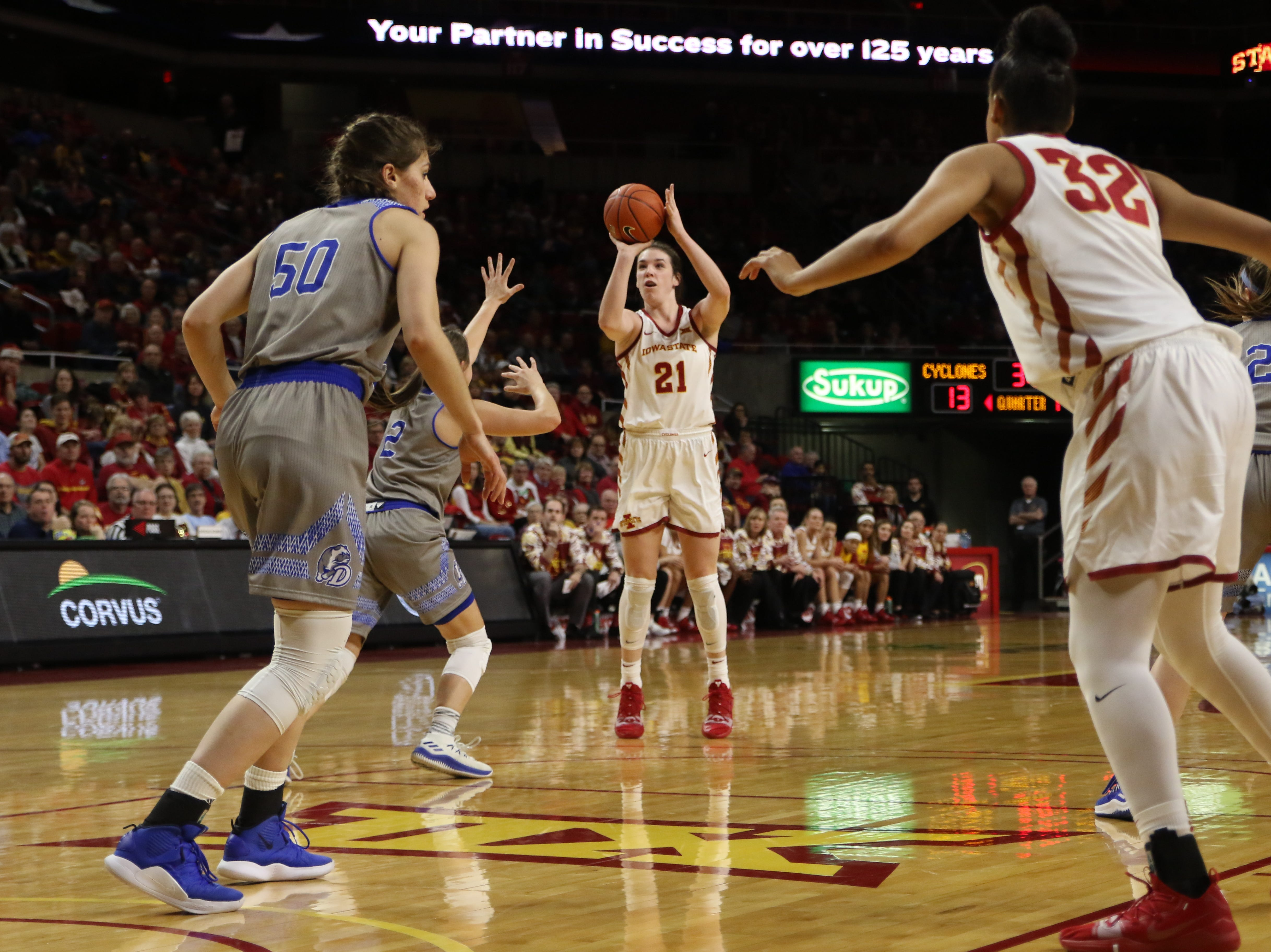 Iowa State senior Bridget Carleton attmepts a three-point shot during the second quarter against Drake on Sunday. Carleton provided a spark for the Cyclones who began the game shooting poorly from beyond the three-point line. The Cyclones won, 86-81.