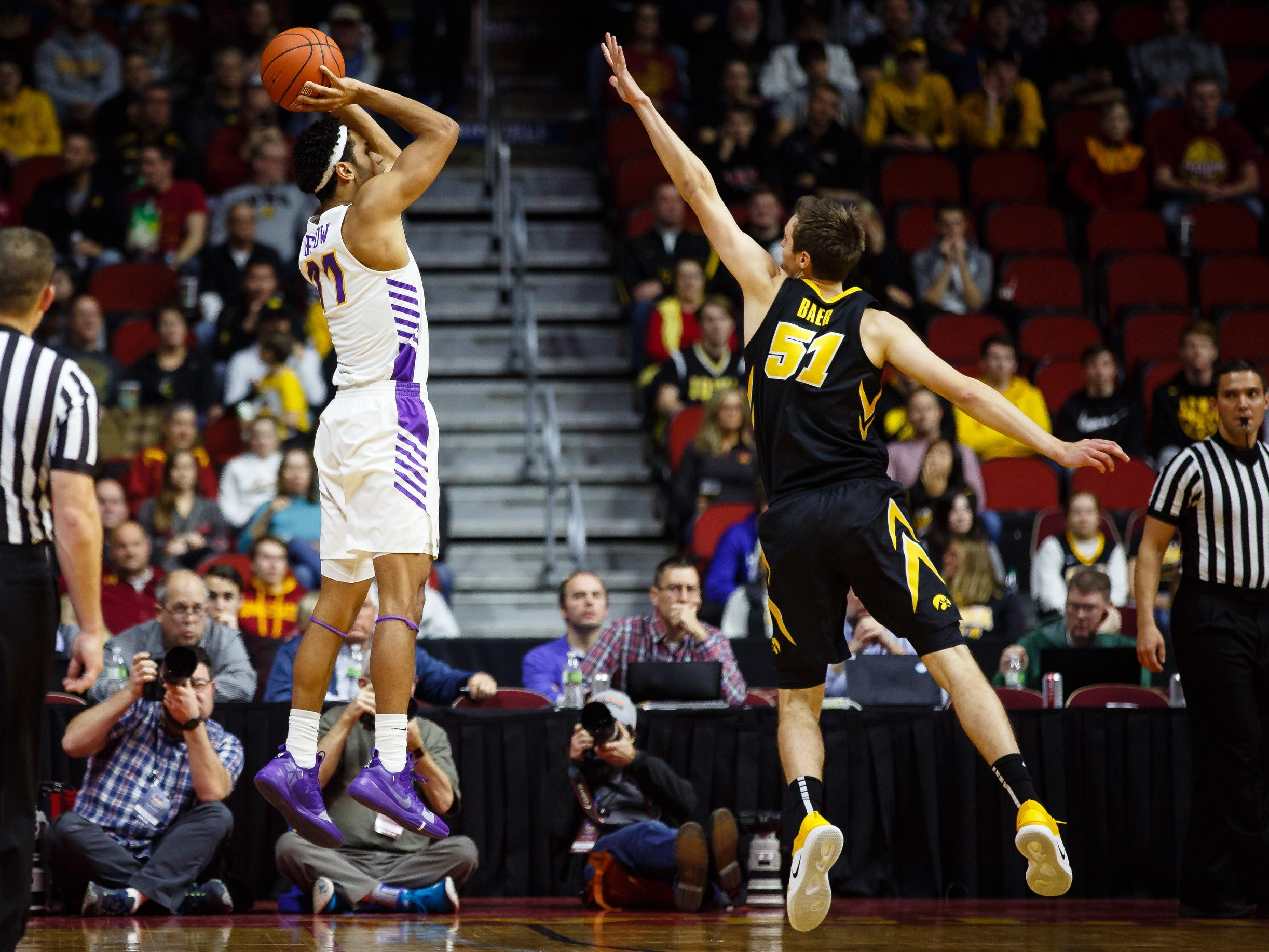 UNI's TraeÊBerhow (11) shoots over Iowa's Nicholas Baer (51) during their basketball game at the Hy-Vee Classic on Saturday, Dec. 15, 2018, in Des Moines. Iowa takes a 39-18 lead over UNI into halftime.