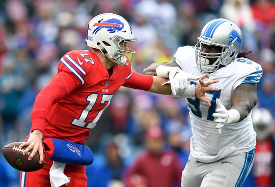 Bills quarterback Josh Allen avoids a tackle by Lions defensive tackle Ricky Jean Francois during the first half on Sunday, Dec. 16, 2018, in Orchard Park, N.Y.