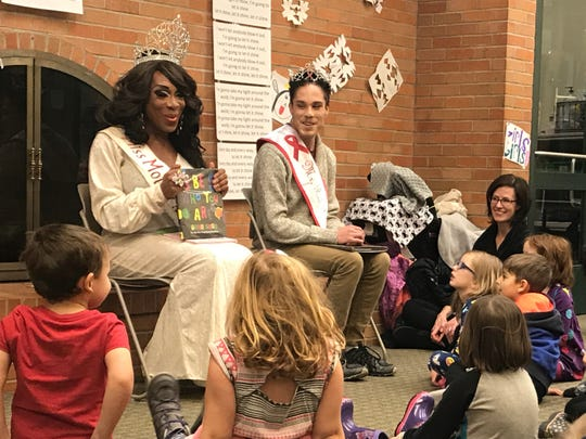 Huntington Woods native Miss Raven Divine Cassadine and her friend Mr. Red Ribbon Dylan read to children in December 2017 as part of the Drag Queen Storytime sponsored by the Huntington Woods Library.