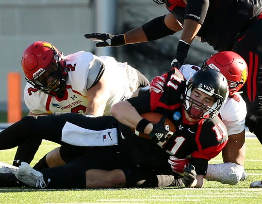 Valdosta State quarterback Rogan Wells is sacked by Ferris State defensive end Austin Edwards during the first half of Ferris State's 49-47 loss in the Division II championship in McKinney, Texas, on Saturday, Dec. 15, 2018.
