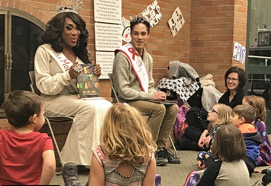 Huntington Woods native Miss Raven Divine Cassadine and her friend, Mr. Red Ribbon Dylan, read to children in December 2017 as part of the Drag Queen Story Time sponsored by the Huntington Woods Library.