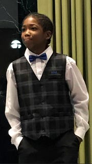 Isaiah Bell, 14, wows the crowd Friday at the Dave Bing Institute anniversary dinner after announcing that he plans to graduate Cass Tech, finish medical school and become a neurosurgeon.
