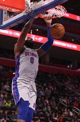Pistons center Andre Drummond slam dunks during the first quarter on Saturday, Dec. 15, 2018, at Little Caesars Arena.