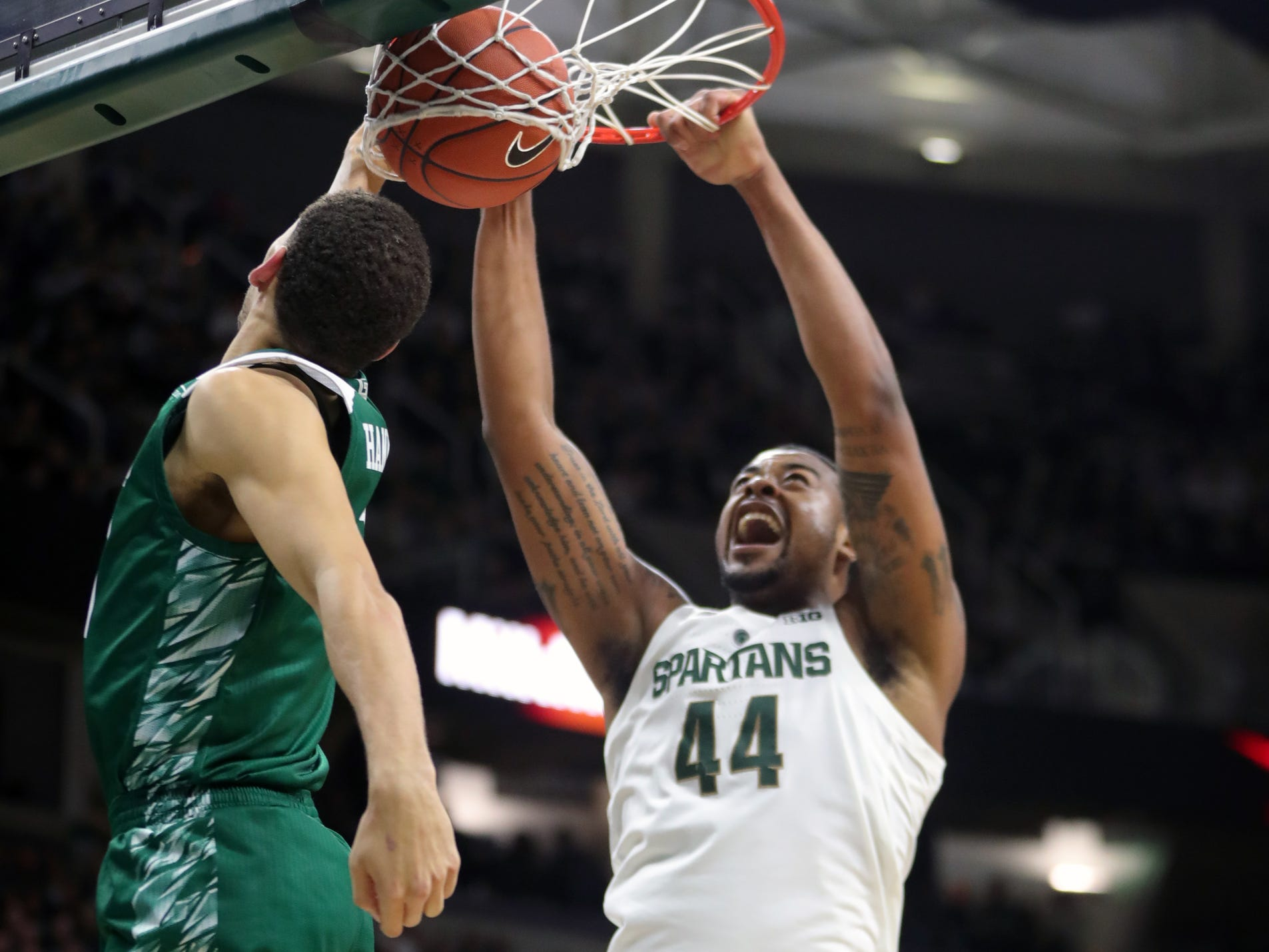 Michigan State forward Nick Ward dunks over Green Bay guard Sandy Cohen III in the first half Sunday, Dec. 16, 2018 at the Breslin Center in East Lansing.