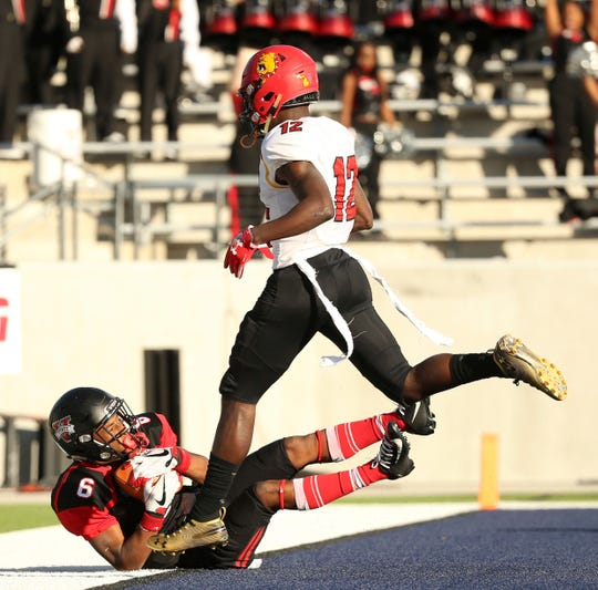 Valdosta State wide receiver Lio'undre Gallimore scores a touchdown against Ferris State cornerback Adrian Green during the first quarter of the Division II national championship game in McKinney, Texas on Saturday, Dec. 15, 2018.