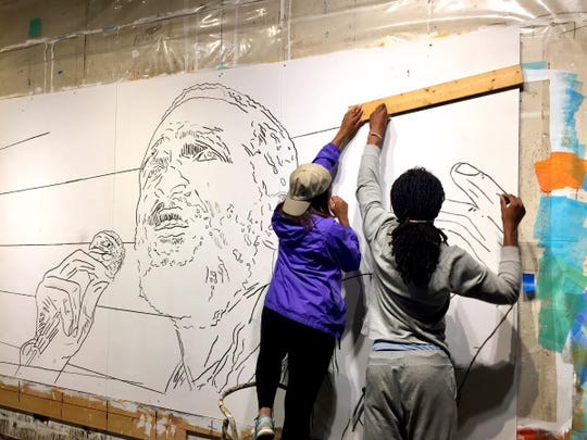 Students from Detroit and Grosse Point Park assisted Nicole Macdonald in the execution of her Marvin Gaye portrait.