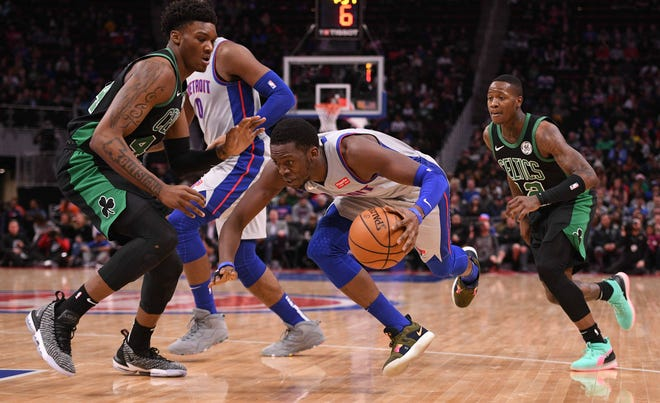 Pistons guard Reggie Jackson drives to the basket as Celtics center Robert Williams defends during the second quarter on Saturday, Dec. 15, 2018, at Little Caesars Arena.