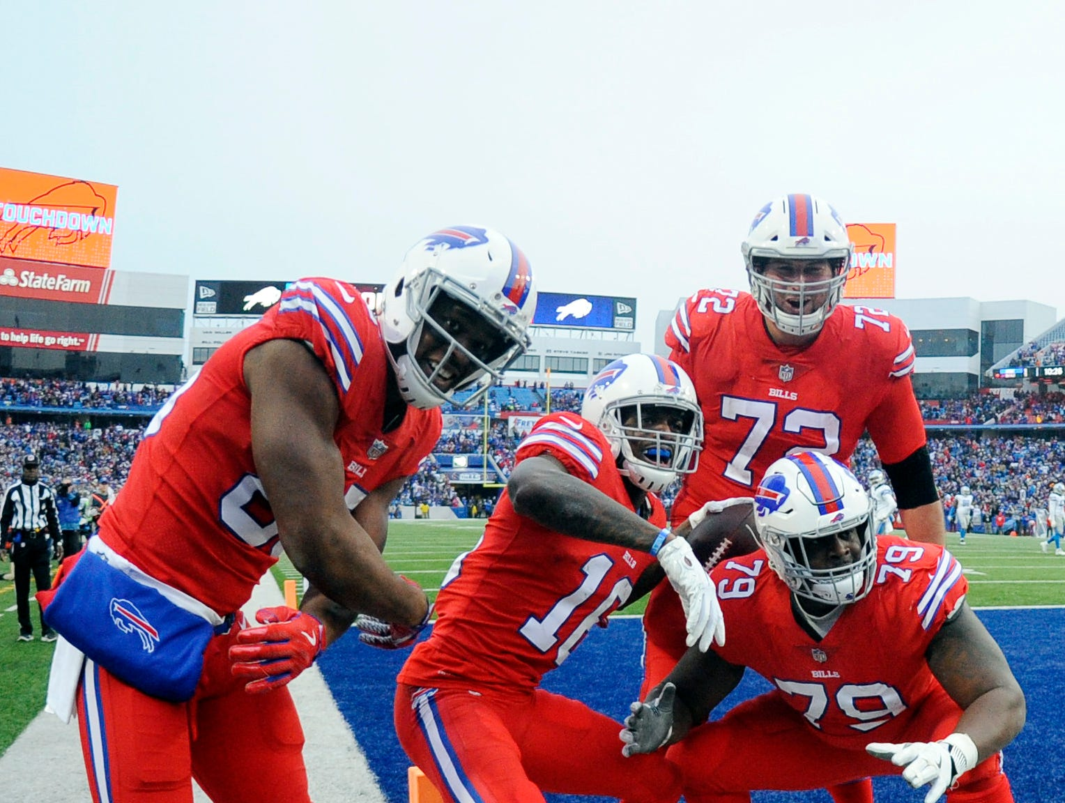 Buffalo Bills wide receiver Robert Foster, second from left, celebrates with teammates after Foster scored a 42-yard touchdown during the second half.
