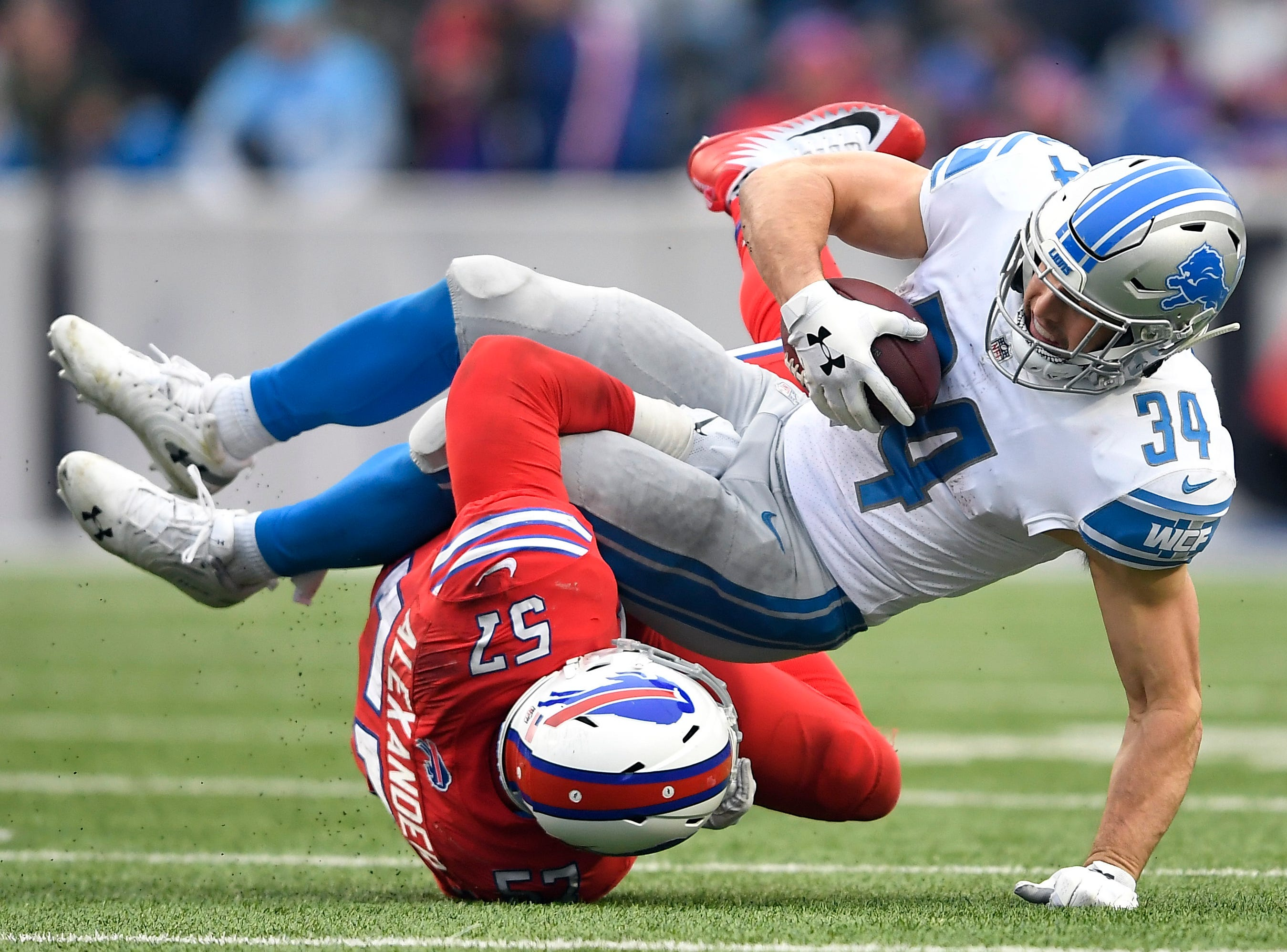 Detroit Lions running back Zach Zenner (34) is tackled by Buffalo Bills outside linebacker Lorenzo Alexander (57) during the second half.