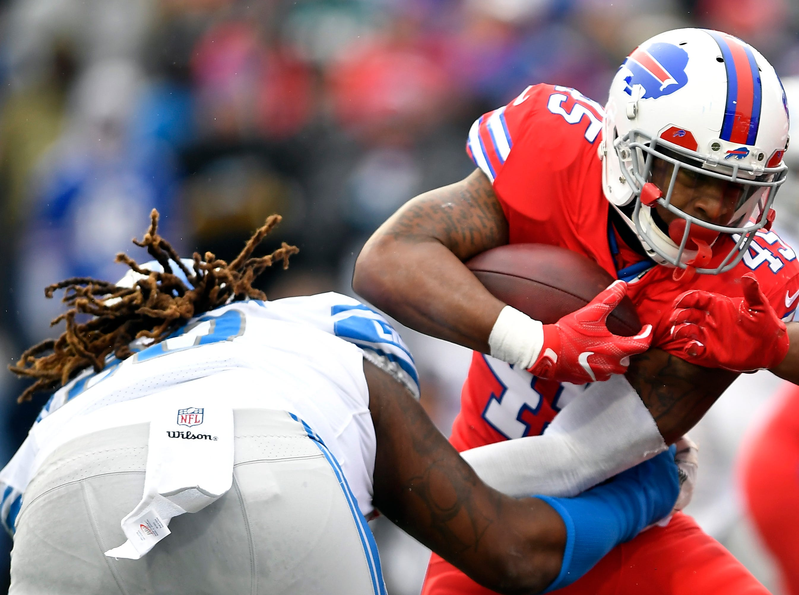 Buffalo Bills running back Marcus Murphy (45) rushes against Detroit Lions defensive tackle Damon Harrison (98) during the first half.