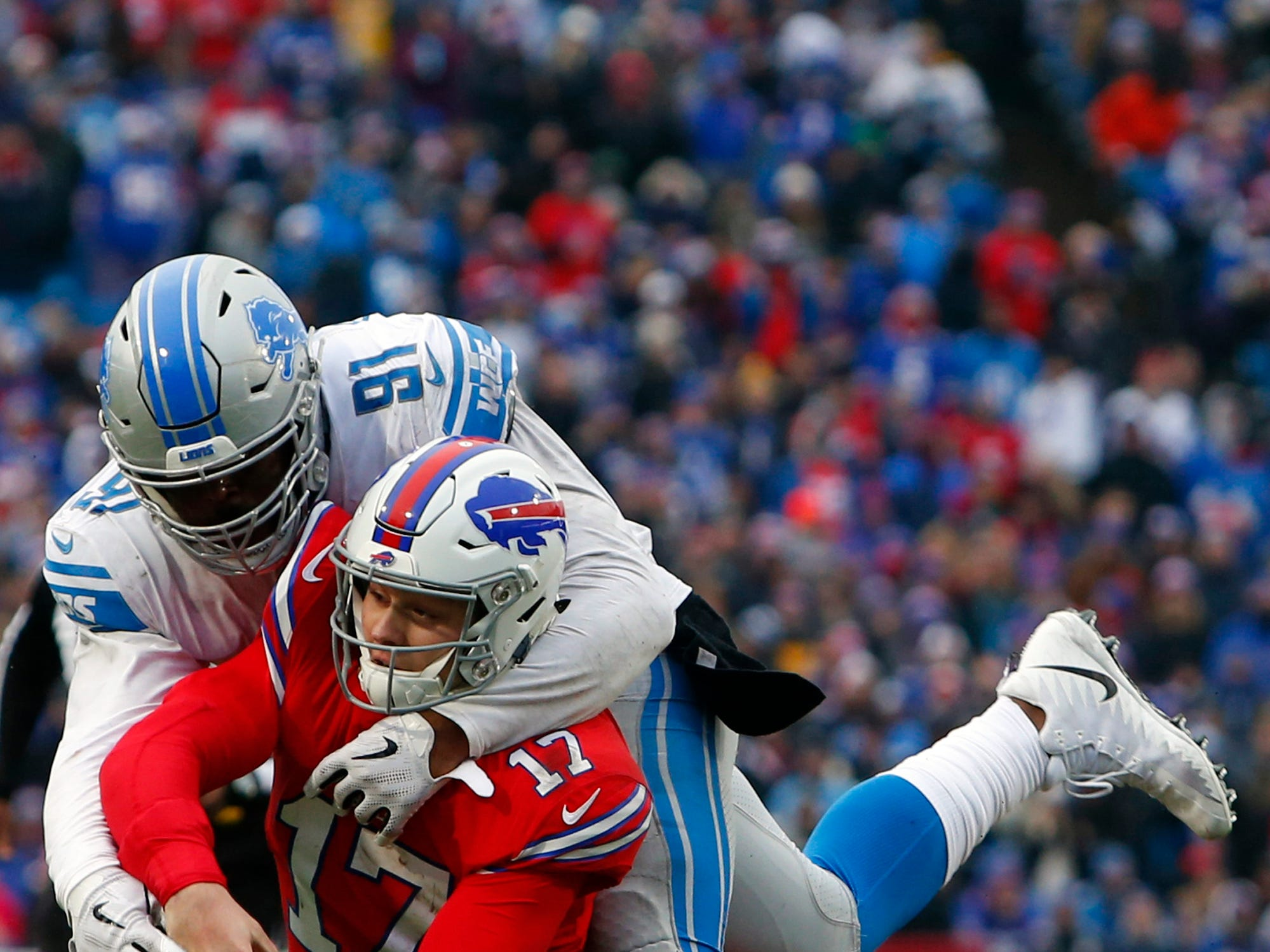 Buffalo Bills quarterback Josh Allen (17) is tackled by Detroit Lions defensive tackle A'Shawn Robinson (91) during the second half.