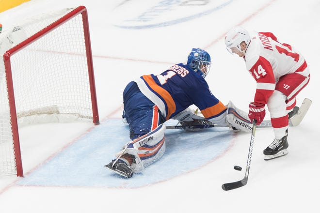New York Islanders goaltender Thomas Greiss  makes a save against Detroit Red Wings right wing Gustav Nyquist during the shootout.
