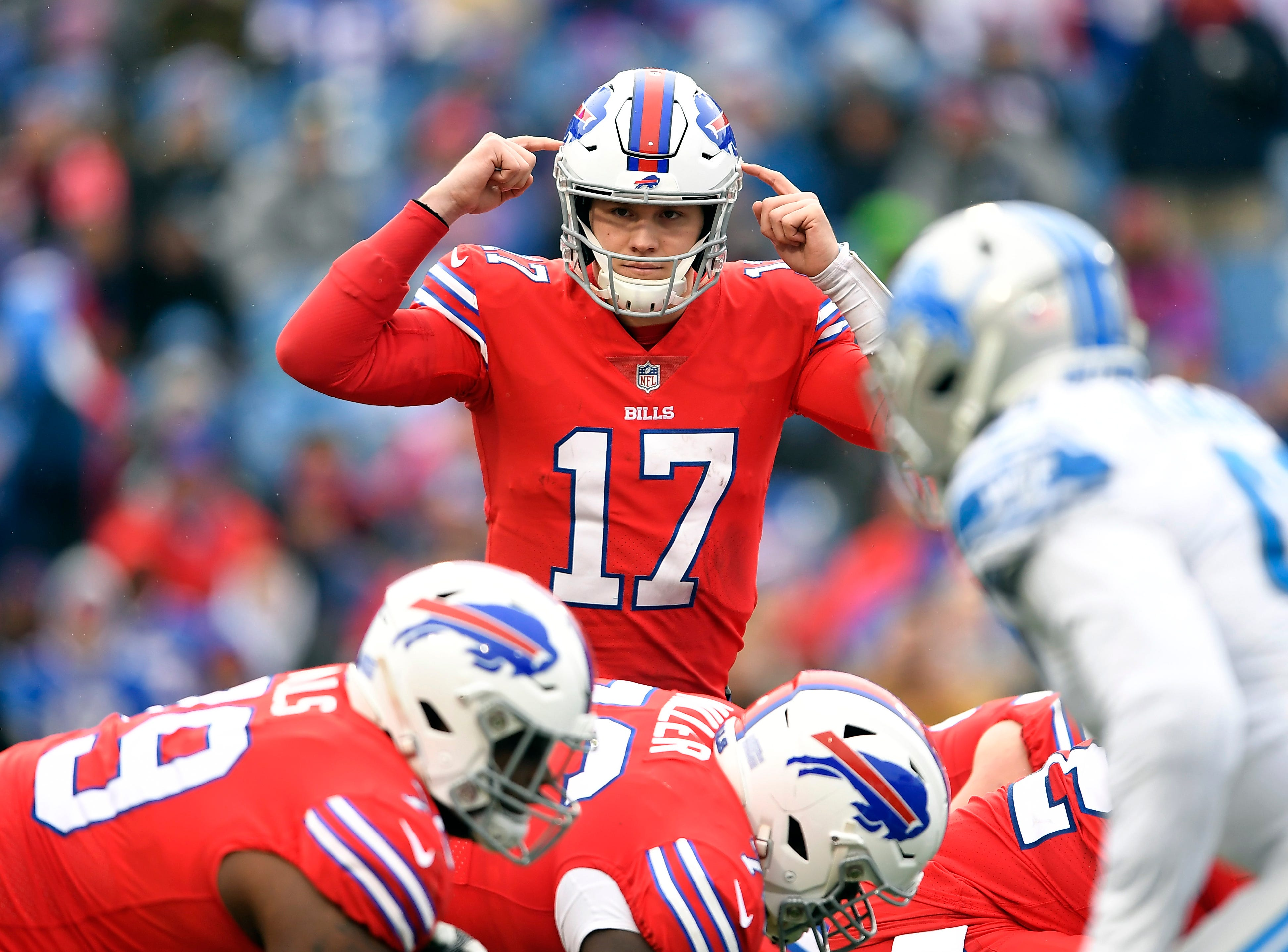 Buffalo Bills quarterback Josh Allen (17) gives a signal to teammates during the first half.