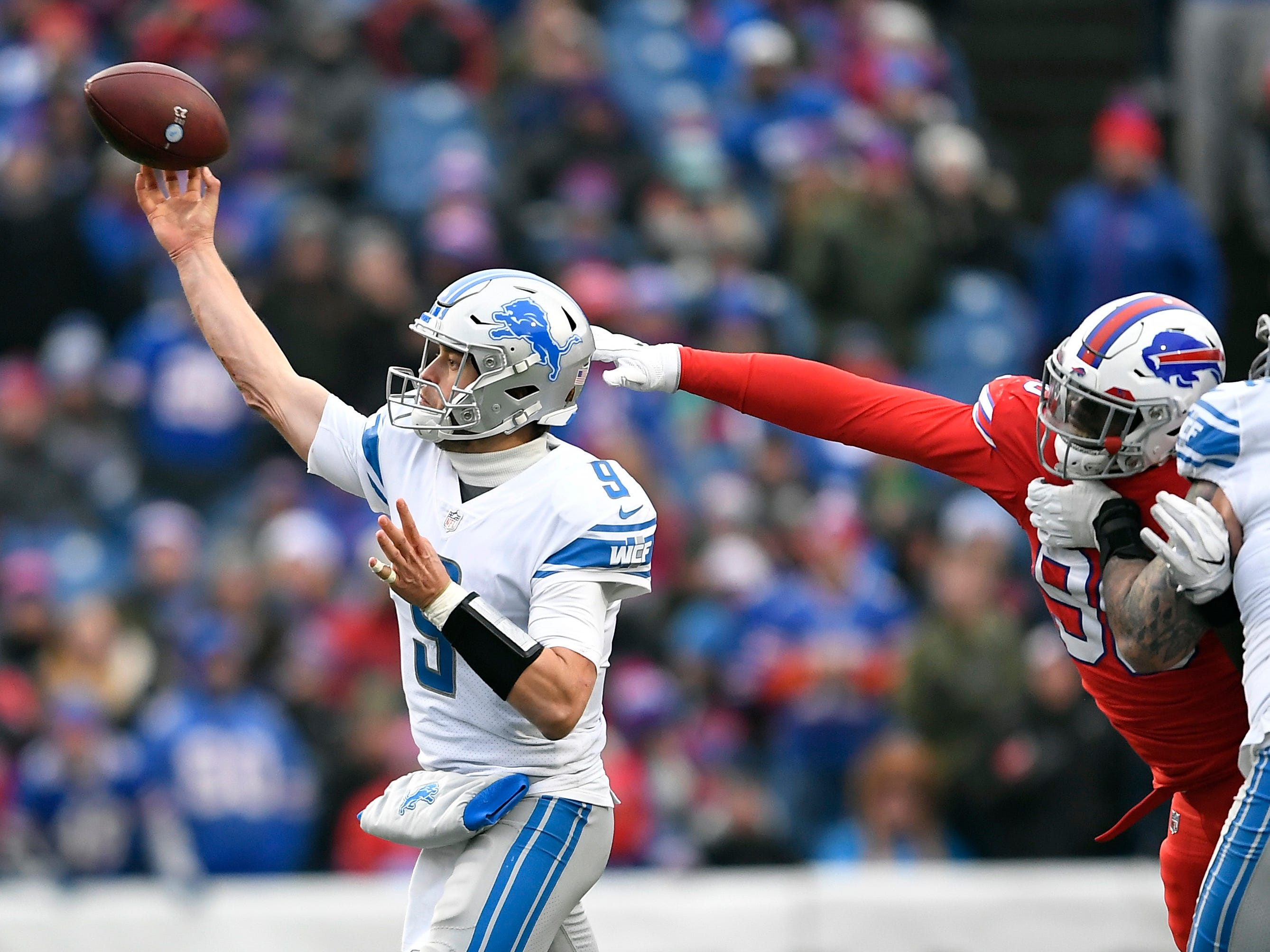 Detroit Lions quarterback Matthew Stafford (9) throws during the second half.