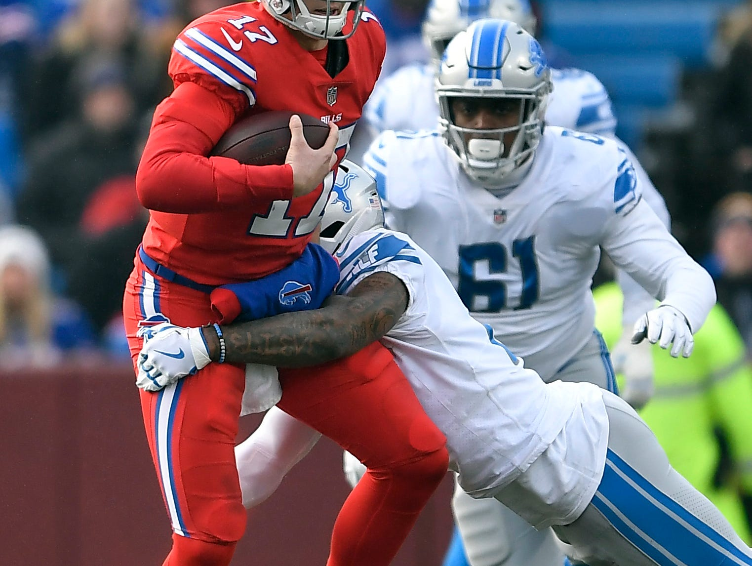 Buffalo Bills quarterback Josh Allen (17) is tackled by Detroit Lions free safety Glover Quin (27) during the first half.