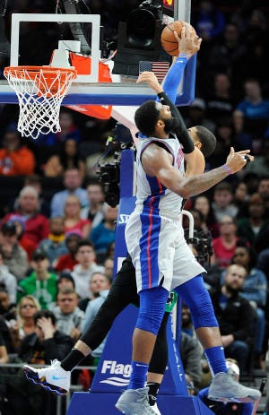 Pistons' Andre Drummond blocks the dunk attempt by Celtics' Jayson Tatum in the fourth quarter. Drummond had 19 points, 20 rebounds and five blocked shots.