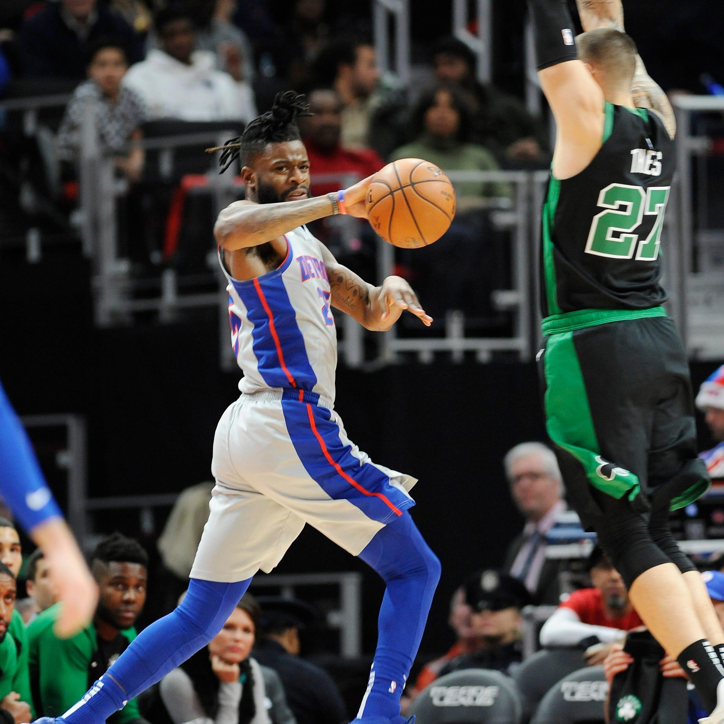 Pistons' Reggie Bullock makes a pass over...