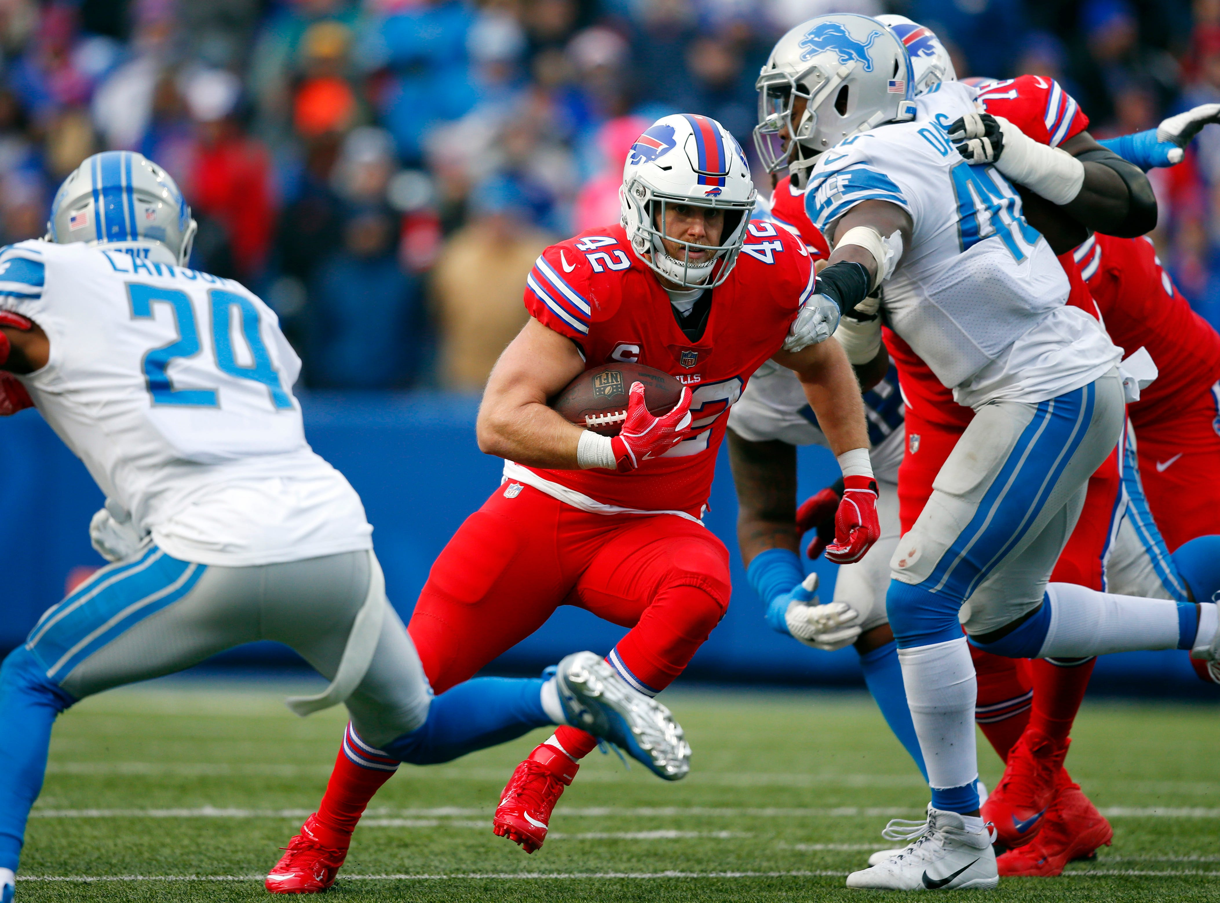Buffalo Bills running back Patrick DiMarco (42) rushes against the Detroit Lions during the second half.