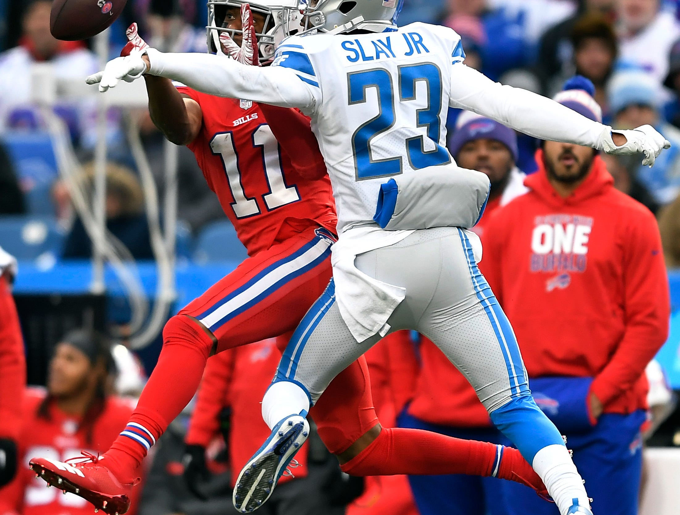 Buffalo Bills wide receiver Zay Jones (11) can't catch a pass under pressure from Detroit Lions cornerback Darius Slay (23) during the second half.