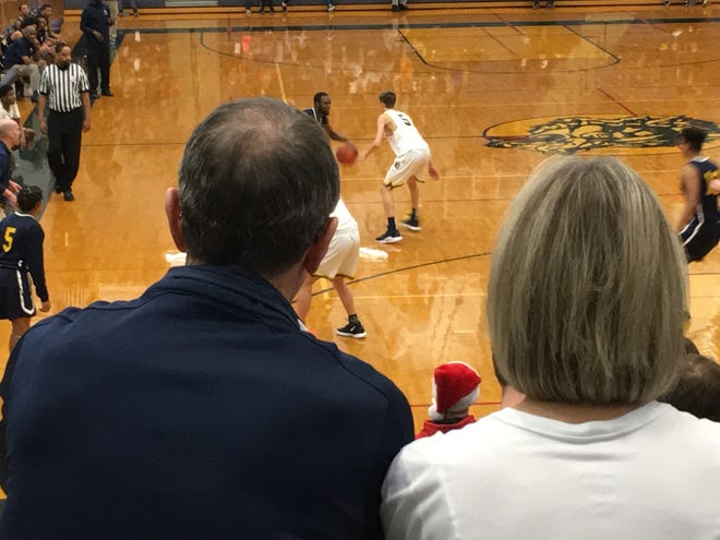 Dan Fife, with wife Jan, enjoys the view of the court that now carries his name on Friday night in Clarkston's game against Wayne.