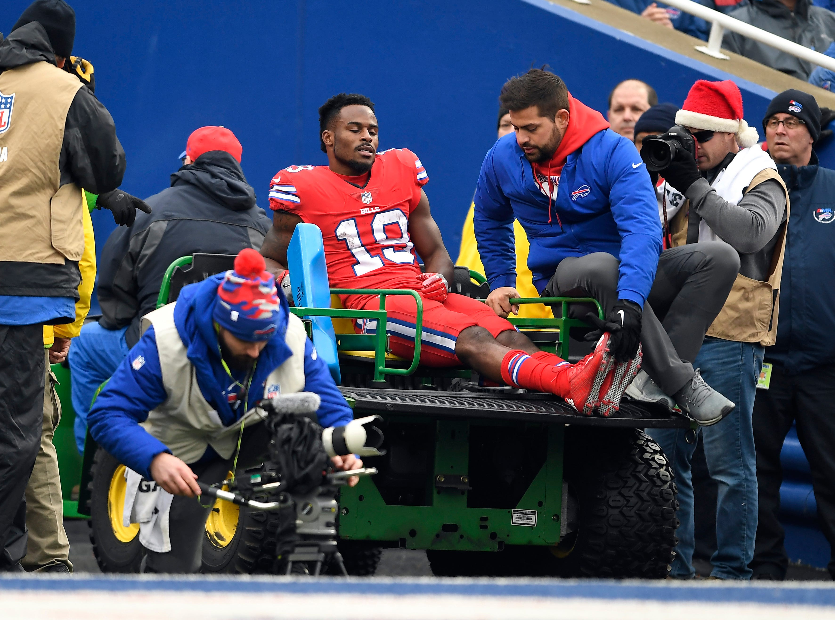 Buffalo Bills wide receiver Isaiah McKenzie (19) is carted off after field with an injury during the second half.