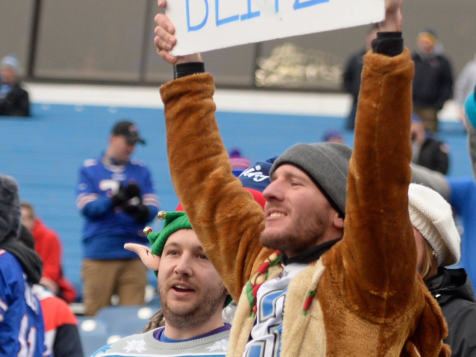 A Detroit Lions fan holds up a sign before an NFL football game between the Buffalo Bills and the Detroit Lions.