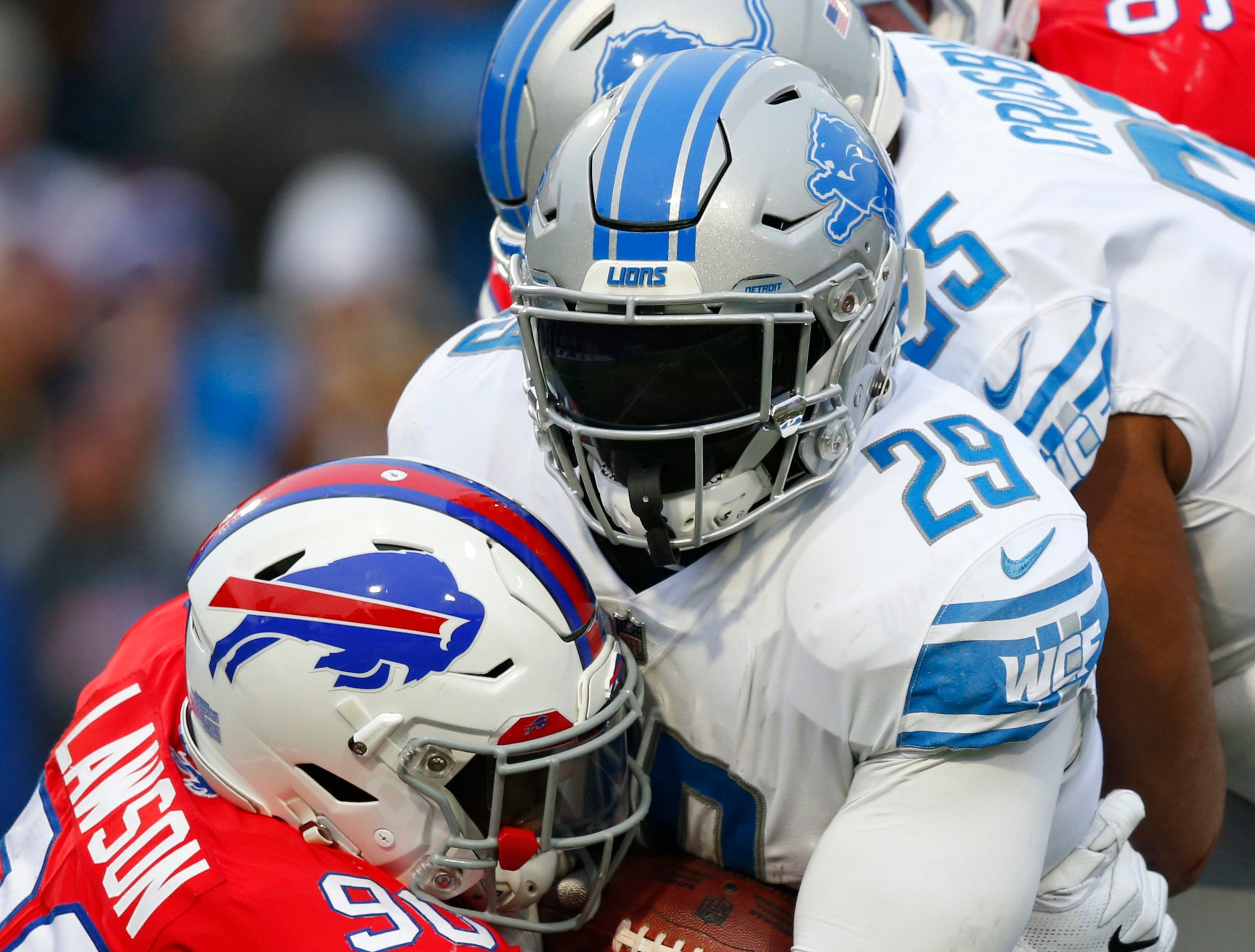 Detroit Lions running back LeGarrette Blount (29) is tackled by Buffalo Bills defensive end Shaq Lawson (90) during the second half.