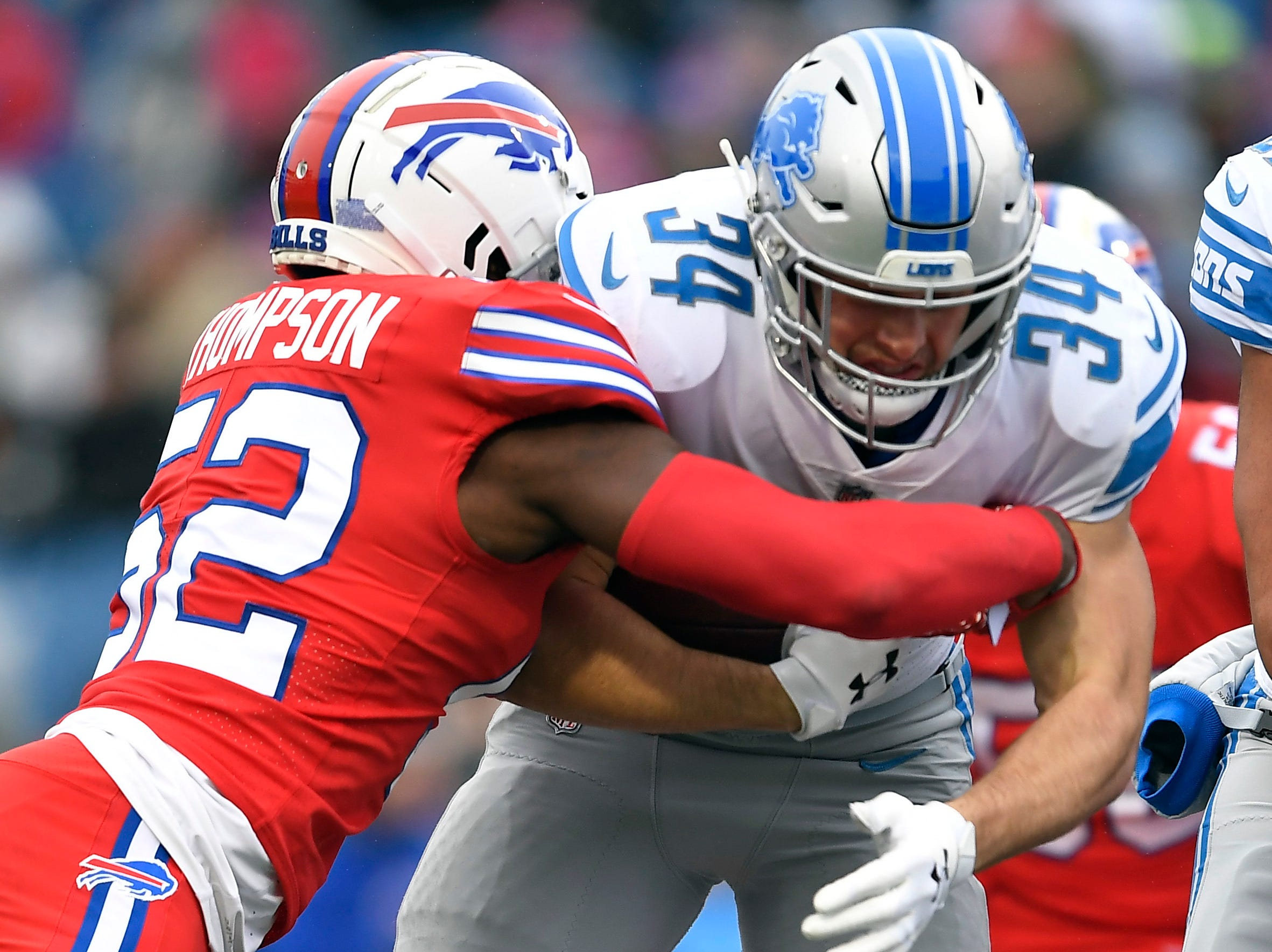 Detroit Lions running back Zach Zenner (34) rushes against Buffalo Bills linebacker Corey Thompson (52) during the first half.