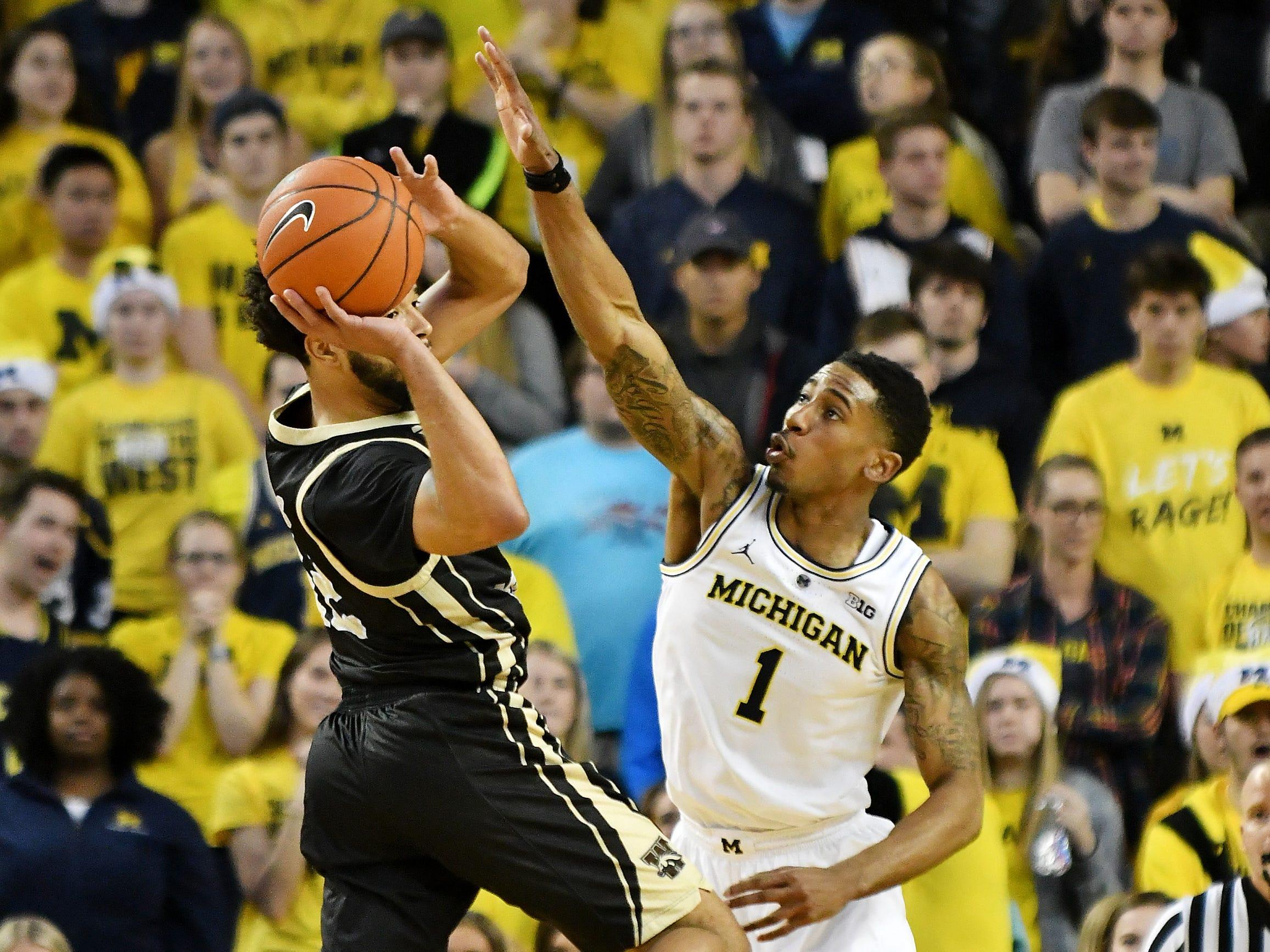 Michigan guard Charles Matthews (1) defends Western Michigan guard Michael Flowers (12) in the second half.