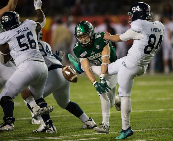 Eastern Michigan wide receiver Mathew Sexton (87) blocks a punt during the Camellia Bowl.