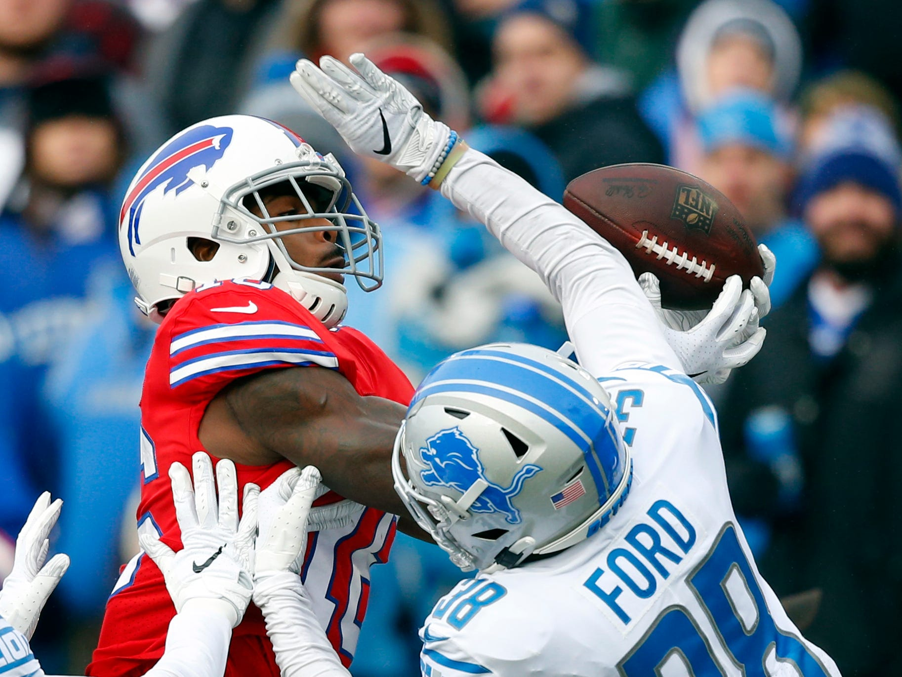 Buffalo Bills wide receiver Robert Foster (16) catches a pass under pressure from Detroit Lions defensive back Mike Ford (38) during the first half.