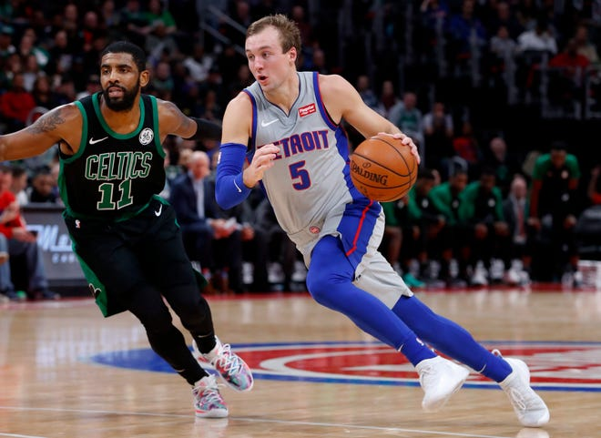Detroit Pistons guard Luke Kennard drives on Boston Celtics guard Kyrie Irving in the second half.