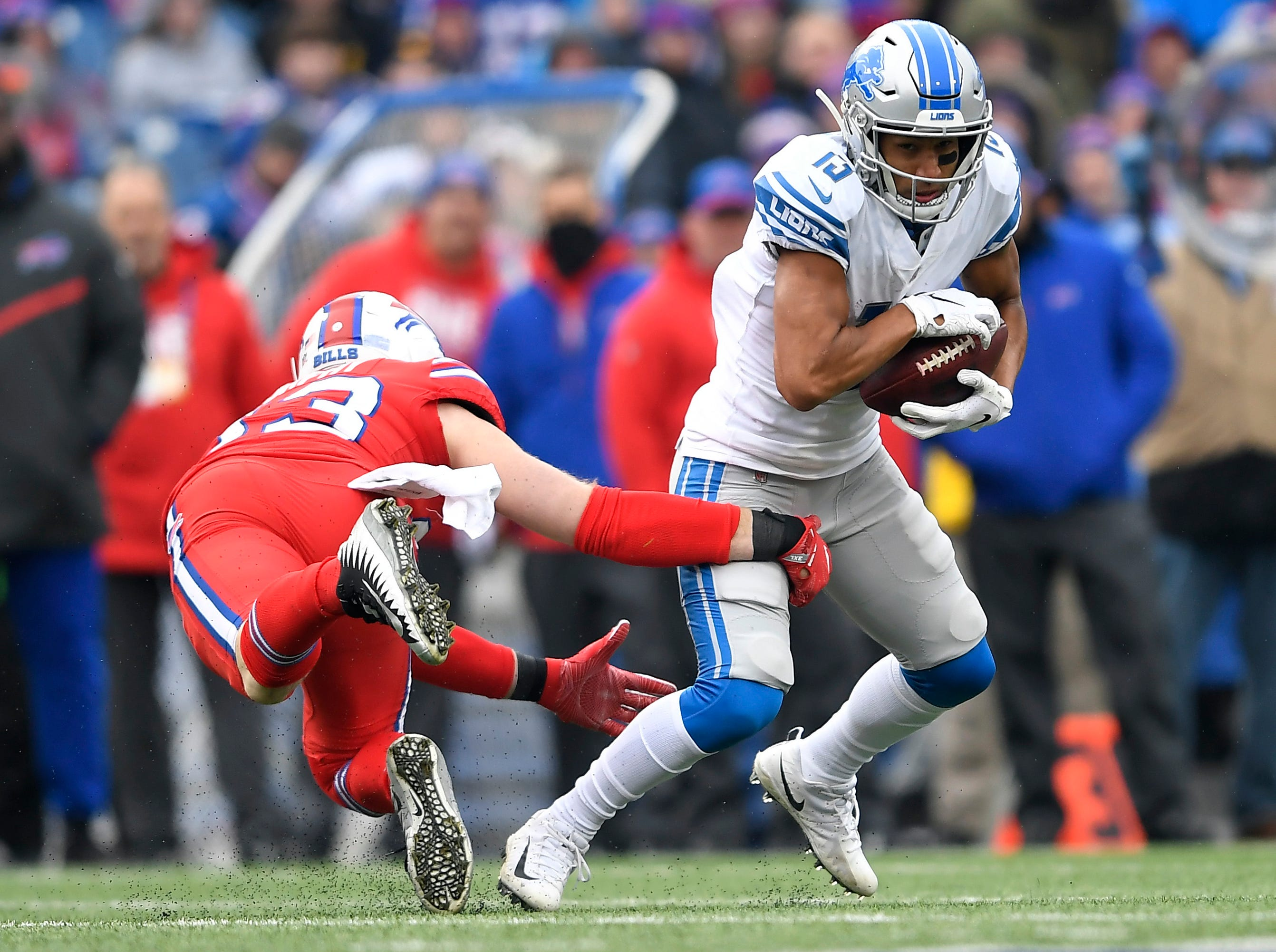 Detroit Lions wide receiver T.J. Jones (13) avoids a tackle during the first half.