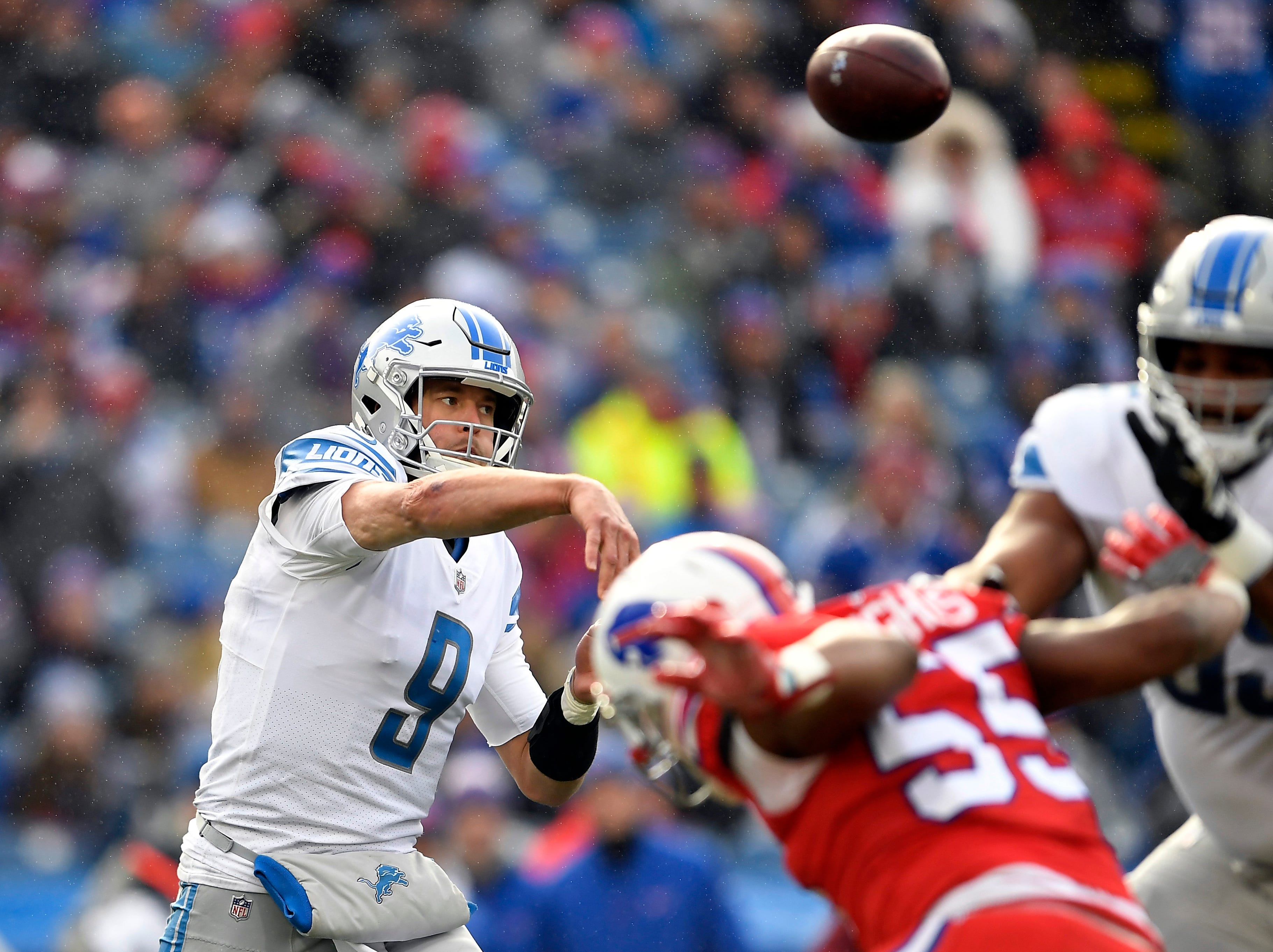 Detroit Lions quarterback Matthew Stafford (9) throws during the first half.
