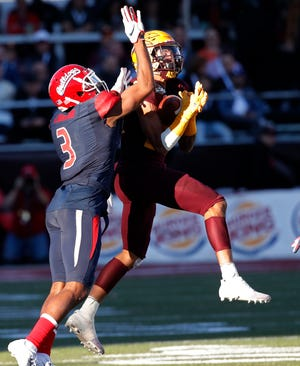 Arizona State defensive back Chase Lucas (24) makes an interception against Fresno State wide receiver KeeSean Johnson (3) during the second half.